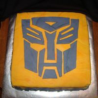"Transformer   10inch square devilsfood 2 layer bc then ""fire pool"" of fondant and fondant cut out transformer"