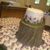"Liz's Woodland Wedding  Devil's food, white, and lemon cupcakes with a spice cake 6"" topper. Groom is arborist who cut stumps, bride works at hobby store..."