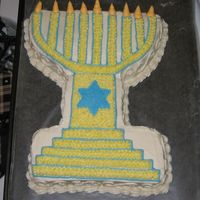 Menorah For the top of the menorah, I used a round cake pan, cut the cake in half, and stacked them. For the bottom, I cut up a sheet cake and...