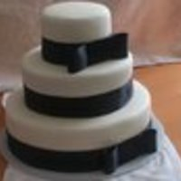 Wedding Cake Red velvet cake, cream cheese icing, Buttercream Fondarific, black satin ribbon. Used SPS which is fabulous.