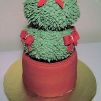 Eugenia Topiary Cake Here is a picture of the ckae BEFORE it fell lopsided, and had to be held up with strings while Happy Birthday was sung. I made the balls...