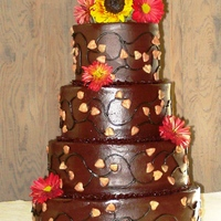 Autumn Wedding Butter Cake with Bitter Sweet Chocolate Frosting. On the sides are piped vines and royal icing piped leaves. The picture truly does not do...