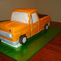 65 Chevy Truck Chocolate 1965 Chevrolet Truck covered in fondant with fondant accents.