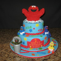 Sesame Street Birthday Cake Mixed a couple of cakes found on CC -- and many thanks to my CC friend for instructions on how to make Elmo. Making the figurines were...