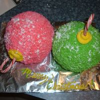 2 Christmas Ornaments This is my first attempt at a 3D cake. It's all buttercream sprinkled with powdered sugar snow. :0)