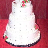 Red & White Wedding Cake! My 1St One Ever! This was my very 1st wedding cake! I was SO nervous! I am still not very good at smoothing out the icing! I just cant get it down! If...