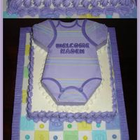 Purple Onsie Cake  1st time doing a Onsie Cake. It was fun. Carved from my T-Shirt Pan. Top tier is Chocolate Butter, bottom is Lemonilla Butter. WC IMBC....