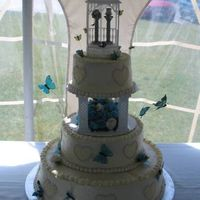 Blue Flowers And Bugs Front The bride wanted blue flowers, bugs, and a gazebo. Those are pewter Pez dispensers in the little gazebo. Flowers are fondant/gum paste (...