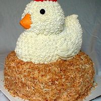 "Chicken Customer wanted a ""big chicken cake,"" so this is what she got. The ""nest"" is covered in toasted coconut."