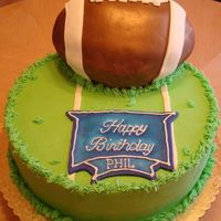 Football Fan Cake This was my first attempt at making a 3-d football cake. It finally starting looking like a football once a put the stipes on it. Then I...