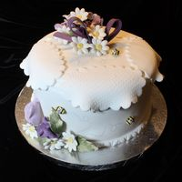 White Fondant With Gumpaste Flowers The cake is chocolate with rasberry and chocolate buttercream filling. It is covered with fondant & gumpaste flowers. Thanks for...