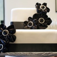Black And White Shower Cake This is a chocolate cake with cream cheese filling. I covered it with white Fondex (my ultimate favorite fondant!) The flowers were made...