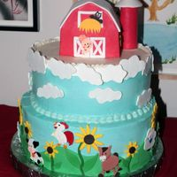 "Farm Theme Birthday Cake This is a cake I made for my grandaughter's 1st birthday. It is a 12"", 10"" and 4.5"" cake. Chocolate cake with fudge and..."