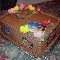 Hawaiian Luau Cake This is a dark chocolate cake with chocolate bcf. The flowers are gumpaste and the travel stickers are pictures I made and laminated. It...