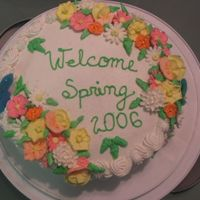 Sring Is Almost Here... Chocolate cake with sweet condensed milk filling decorated with royal icing flowers and color flow birds. Icing is buttercream.