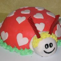 Love Bug Chocolate cake with whipped cream and maraschino cherries filling, covered and decorated with Fondant. Antennae are Twizzlers.