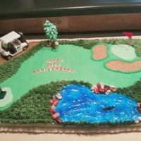Golf Cake   Cake I made for a friend who loves golf. Piping gel lake, chocolate rocks and fondant greenways.
