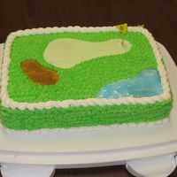 Golf Cake   Made for a golf finatic! Sand is brown sugar. Water is colored piping gel. Flag is fondant.