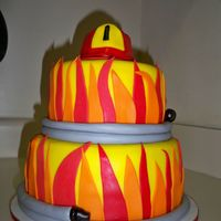 Fireman Cake Hat made from cupcake covered in fondant. Hose for border.