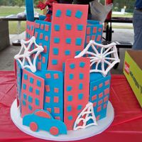 Spiderman Cake Buildings made from gumpaste, royal icing webs. I never want to do another spiderman cake again....I could not come up with anything for it...