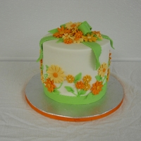 Voni Quick birthday cake for a friend. She loves my wedding cake design that is similar but wanted to change the colors to orange and green....