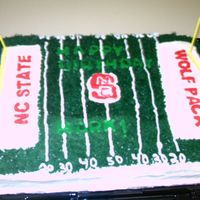 Football Field sheetcake iced in bc with fondant letters to look like happy birthday was cut in the grass. the emblems and wording were fbct's my...
