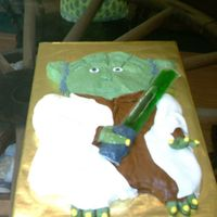 Yoda this was for my nephew's birthday it is a sheet cake carved to shape iced in bc popicle for light saber. first attempt at using mmf....