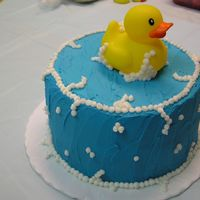 Duckie Cake This cake was so much fun! I made it for my son's first birthday. The rubber duckie is plastic, everything else is buttercream. I am...