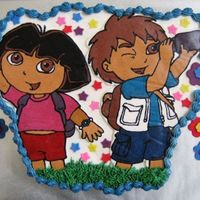 Dora/diego Cupcake Cake 24 Vanilla cupcakes with buttercream transfer and fondant accents.