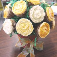 Flower Bouquet For A Special Teacher These were carrot cake frosted with crusting cream cheese icing. They held up rather well. Two on the bottom though fell off after a couple...