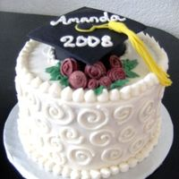 Graduation Cake Strawberry cream cake with fondant cap/tassel and roses.