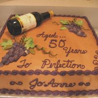 Wine Lover Cake Banana fudge cake with chocolate buttercream, wine bottle and fondant grapes/accents