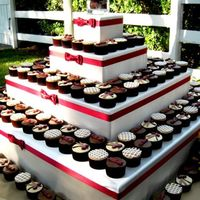 Napa Cupcake Wedding Handmade square tier, wrapped in satin and trimmed with ribbon and bow. 200 cupcakes in 3 different flavors , all with different icing and...