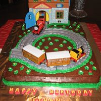 Thomas The Train On this one I did two 9x13 cakes and put them together. Iced the whole thing in chocolate icing. Added the track and train station and...