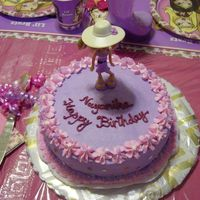 Bratz B'day Cake This was my daughters 6th b'day cake with Bratz theme and the color scheme was pink and purple. The Bratz doll on the cake is a...