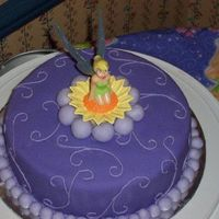 Tinkerbell  I made this cake for my 2 year old's birthday. I had to decotate it *again* that morning. My two girls thought it was a good idea to...