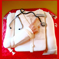 Doctors Coat Cake With 3-D Arm Graduation Cake for a Physicians Assistant. Asked for a hand pointing to the name tag and title plus a stethoscope. Everything is edible...