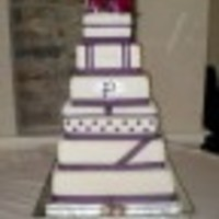 Jenna's Wedding Cake 6-8-10-12-14 & 16 inch squares covered with fondant and each layer designed differently.