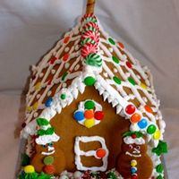 Gingerbread House I made royal icing to glue the base together then let my 2 kids (ages 6 & 8) decorate away. This is what they came up with.