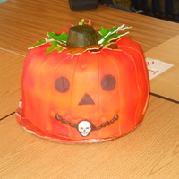 Pumpkin Cake My 1st try at a Jack-o-Lantern cake. Pumpkin spice cake with Dream Whip icing and fondant. Good rave reviews at the school party.