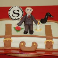 Suitcase Cake For Hotel Manager This was for the manager of the Sheraton Hotel who is relocating to another country. The candle, rose, and music note all have significance...