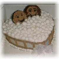Hot Tub Couple The couple are cupcakes, and the bubbles are fondant. This sat on a sheet cake.