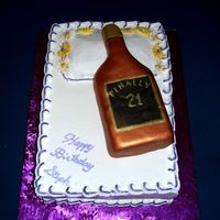 21St Birthday Cake With A Bottle And A Pillow I did this for one of the secrateries at work who was turning 21. Double layer lemon cake. Bottle was shaped out of rice crispies, then...