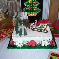 Christmas Party This one I did for my sisters christmas party. Double layer 10x15, one layer yellow, one layer chocolate, frosted with whipped buttercream...