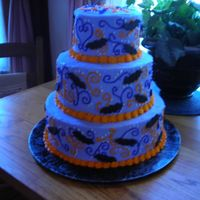 "Halloween Wedding Cake 12"", 9"", 6"" lavender buttercream with orange and purple scrolls. The bats are made out of fondant. Surprisingly, this was a..."