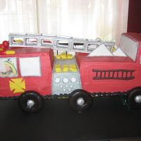 Firetruck Firetruck was made for little boy. Used 1//4 sheet cakes and stacked and carved shape. Used choc covered doughs for tires. Ladder is made...