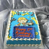 Bob The Builder! Vanilla cake with chocolate Bob the Builder. Used star tip for wrenches and bolts.