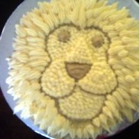 Lion_2.jpg This is a 6 inch round cake decorated in B/C icing made to look like a lion. The Lions mane is made by using a star tip (#32).