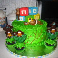 Monkey Around At Baby Shower Ask to make a cake with a monkey with a diaper on it. Cake has a layer of vanilla, chocolate and banana cake. Covered in BC, air brushed...