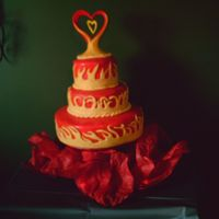 Flame Wedding Cake This was my first fondant cake. The couple wanted it to match their custom painted motorcycle. The topper is the white Wilton porcelain...